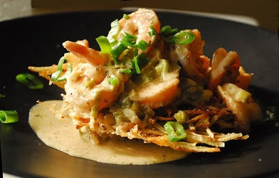 Shrimp In A Mustard Sauce Over Crispy Potato Cakes