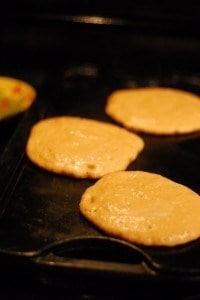 Heat a greased griddle, and drop ladle fulls of batter on to griddle.