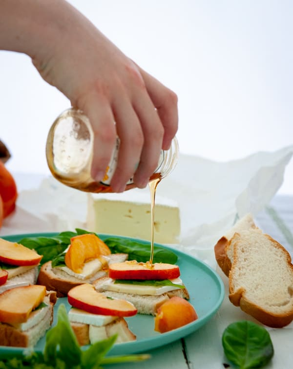 Basil Peach Brie Crostini with honey drizzle