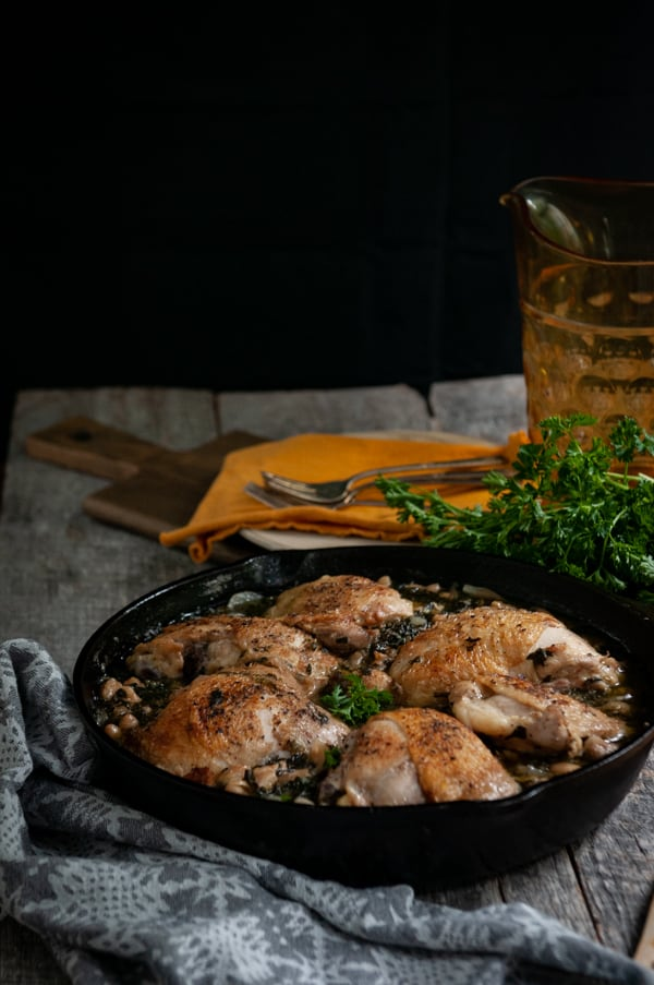 White Wine Braised Chicken Thighs with Spinach and White Beans - an easy comforting fall dinner! #chickenrecipes #chickenthighs #spinach #whitebeans #easyrecipes #slowcarb #braised #braising