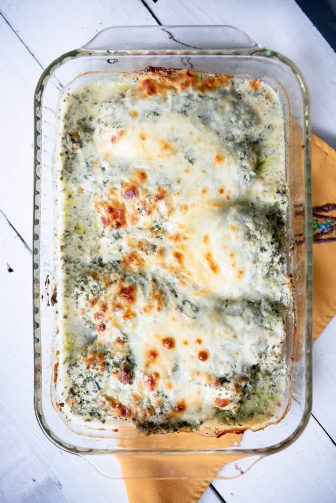 Keto Spinach Artichoke Chicken in a casserole dish