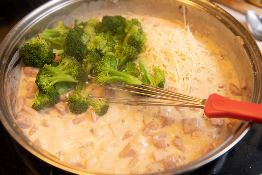 Add in broccoli and parmesan